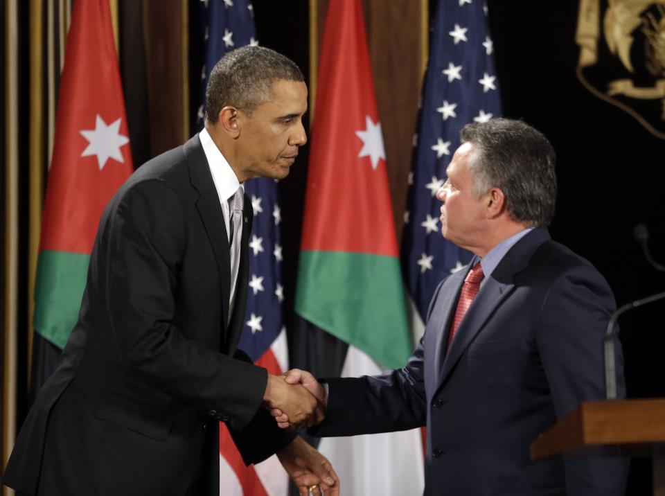 U.S. President Barack Obama, left, and Jordan's King Abdullah II, right, shake hands following their joint new conference at the King's Palace in Amman, Jordan, Friday, March 22, 2013. (AP Photo/Pablo Martinez Monsivais)