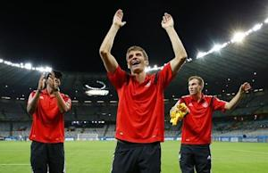 Germany's national soccer players celebrate after their 2014 World Cup semi-finals against Brazil at the Mineirao stadium in Belo Horizonte