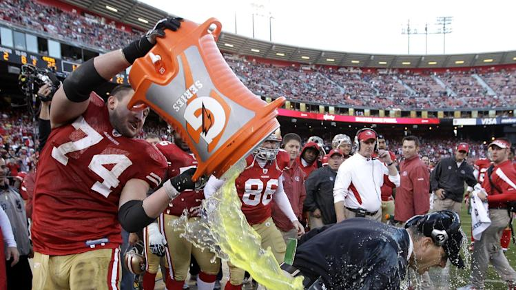 San Francisco 49ers offensive tackle Joe Staley (74) dumps gatorade on head coach Jim Harbaugh during the fourth quarter of an NFL football game against the St. Louis Rams in San Francisco, Sunday, Dec. 4, 2011. The 49ers won 26-0. (AP Photo/Paul Sakuma)