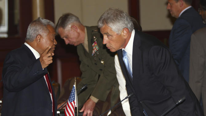 U.S. Defense Secretary Chuck Hagel, right, leans to listen to Indonesian Defense Minister Purnomo Yusgiantoro prior to the start of their meeting in Jakarta, Indonesia, Monday, Aug. 26, 2013. (AP Photo/Dita Alangkara)