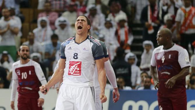 Narcisse of France celebrates winning their final match against Qatar of the 24th Men's Handball World Championship in Doha