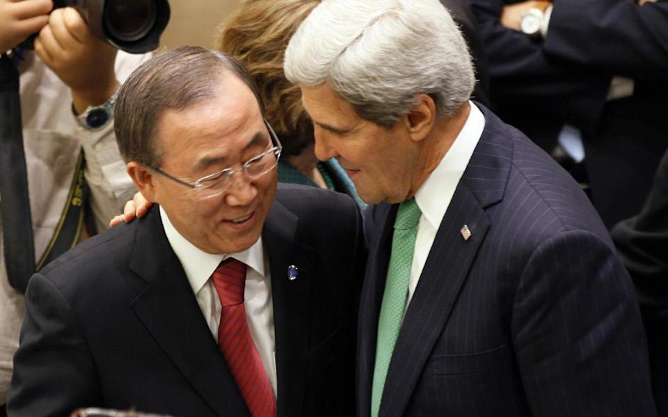 Ban Ki-moon, Secretary General of United Nations, left, and John Kerry, right U.S. Secretary of State attend an Ad Hoc Liasion Committee held at U.N. Headquarters during the 68th session of UN General Assembly Wednesday, Sept. 25, 2013.(AP Photo/David Karp)