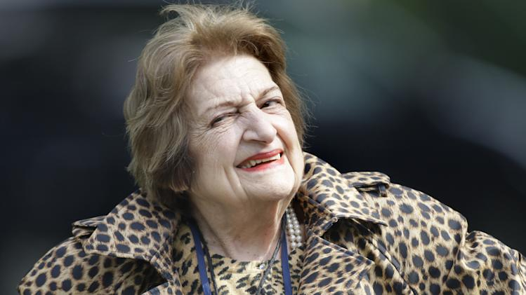 FILE- In this Oct. 16, 2007, file photo, veteran White House correspondent Helen Thomas smiles as she leaves the White House after attending a briefing in Washington. Thomas, a pioneer for women in journalism and an irrepressible White House correspondent, has died Saturday, July 20, 2013. She was 92. (AP Photo/Ron Edmonds, File)