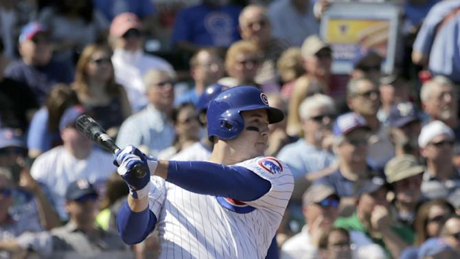 Chicago Cubs' Anthony Rizzo hits an RBI double off Los Angeles Dodgers starting pitcher Clayton Kershaw, scoring Arismendy Alcantara, during the first inning of a baseball game Friday, Sept. 19, 2014, in Chicago. (AP Photo/Charles Rex Arbogast)