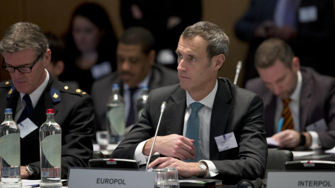 Europol director Rob Wainwright listens to a speech at the start of an anti terror conference at the Europol headquarters in The Hague, Netherlands, Monday, Jan. 11, 2016. (AP Photo/Peter Dejong)