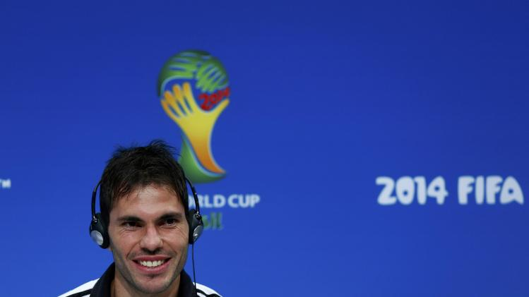 Argentina's Jose Basanta smiles during a news conference at the Maracana stadium in Rio de Janeiro