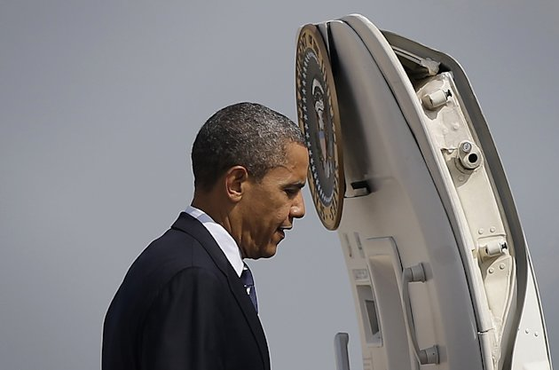 President Barack Obama boards Air Force One before his departure from Andrews Air Force Base, Md., Tuesday, Aug., 28, 2012. Obama is traveling to campaign in Iowa and Colorado today(AP Photo/Pablo Martinez Monsivais)