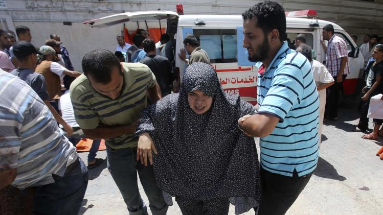 A wounded Palestinian woman arrives at a hospital in Rafah in the southern Gaza Strip