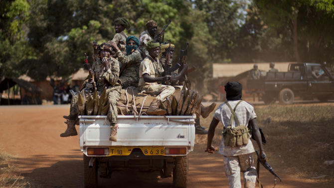 A soldier runs to jump on a moving truck carrying Chadian soldiers who are fighting to support Central African Republic president Francois Bozize, in Damara, about 70km (44 miles) north of the capital Bangui, Central African Republic Wednesday, Jan. 2, 2013. After troops under Bozize seized the capital in 2003 amid volleys of machine-gun and mortar fire, he dissolved the constitution and parliament, and now a decade later it is Bozize himself who could be ousted from power with rebels having seized more than half the country and made their way to the doorstep of the capital in less than a month. (AP Photo/Ben Curtis)