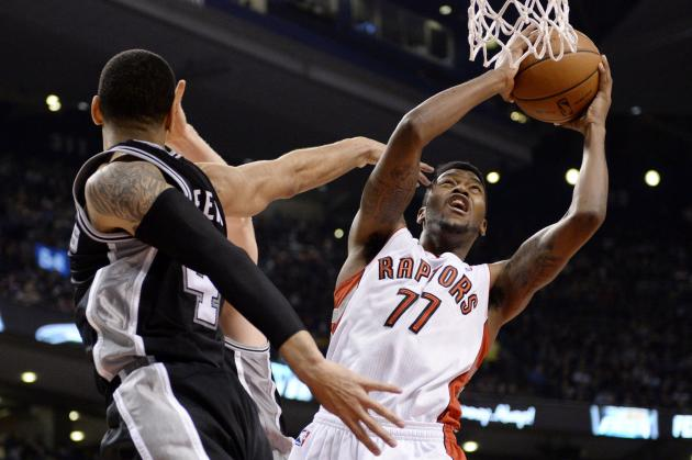Toronto Raptors guard Julyan Stone (77) goes up for a shot as San Antonio Spurs forward Danny Green (4) defends during first half NBA basketball action in Toronto on Tuesday, Dec. 10, 2013