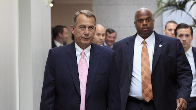"House Speaker John Boehner of Ohio, left, walks to join GOP House members for a caucus meeting on Capitol Hill in Washington, Tuesday, Sept. 10, 2013. Some conservative Republicans want to shut down the government if that's what it takes to block the ""Obamacare"" health program. The fiscal year ends Sept. 30, and government agencies will start shutting down if some type of budget bill isn't enacted by then and Boehner says he wants no government shutdown or default on the debt. (AP Photo/J. Scott Applewhite)"