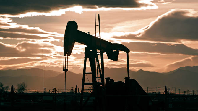 """In this Dec. 5, 2012 photo, the sun sets behind an oil pump jack and the Rocky Mountains near Fredrick, Colo. Citizen fears about hydraulic fracturing, a drilling procedure used to pry oil and gas from rock deep underground, have made """"fracking"""" the hottest political question in Colorado. In November, citizens in the Denver suburb of Longmont voted overwhelmingly to ban fracking despite heavy opposition from the oil and gas industry and warnings of lawsuits. Now the fracking debate is rocking small local governments _ and leaving the industry wondering how to proceed in a state that has long embraced the oil and gas industry. (AP Photo/Ed Andrieski)"""