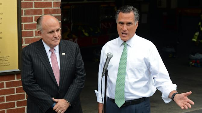 Republican presidential candidate, former Massachusetts Gov. Mitt Romney, accompanied by former New York City Mayor Rudolph Giuliani speaks to the media after touring New York Fire Department Engine 24 Ladder 5, Tuesday, May 1, 2012 in New York. (AP Photo/Henny Ray Abrams)