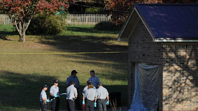 Deputies respond to a call at the home just over the state line in Fayetteville, Tenn., Monday, Oct. 22, 2012. The slayings of three women and a toddler at two homes in southern Tennessee may be related to a body found just across the state line in Alabama, authorities said Tuesday. On Monday, Tennessee officials found three women and an 18-month-old boy dead at two different homes in Lincoln County, about 100 miles south of Nashville. (AP Photo/The Huntsville Times, Sarah Cole)