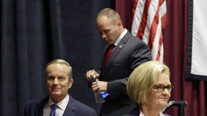Democratic Sen. Claire McCaskill, right, walks off the stage with challengers Republican Todd Akin, left, and Libertarian Jonathan Dine following their debate in the Missouri Senate race Friday, Sept. 21, 2012, in Columbia, Mo. (AP Photo/Jeff Roberson)