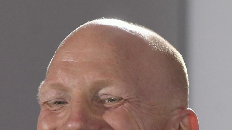 Sammer, sporting director of Bayern Munich laughs during a news conference to present the club's new player Benatia at Bayern Munich's headquarters in Munich