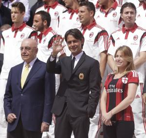 AC Milan coach Filippo Inzaghi, center, poses flanked by AC Milan vice president Barbara Berlusconi, right, and vice president Adriano Galliani during the presentation of the upcoming 2014-15 season at the AC Milan headquarter in Milan, Italy, Thursday, July 10, 2014. (AP Photo/Luca Bruno)