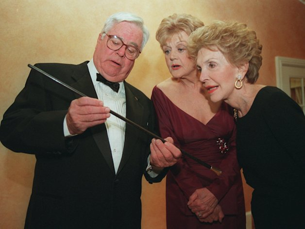 FILE - In this March 23, 1996 file photo, William Windom, left, shows a swagger stick to &quot;Murder She Wrote&quot; star Angela Lansbury, center, and former first lady Nancy Reagan prior to Lansbury being presented the Caritas Award by Mrs. Reagan in Beverly Hills, Calif. Windom, who won an Emmy Award for his turn in the TV comedy series &quot;My World And Welcome To It,&quot; died Thursday, Aug. 16, 2012 of congestive heart failure at his home in Woodacre, north of San Francisco. He was 88. (AP Photo/Frank Wiese)