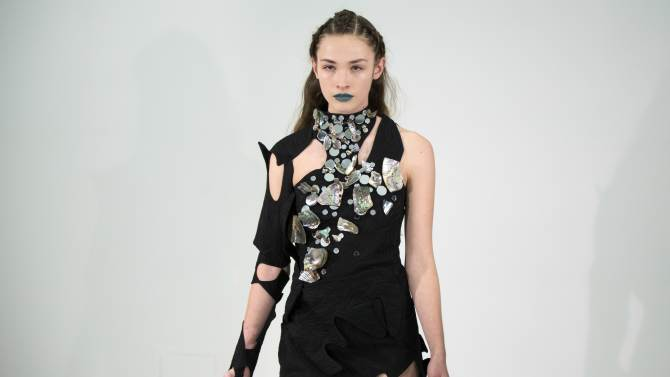 A model presents a creation from the threeASFOUR Autumn/Winter 2013 collection during New York Fashion Week