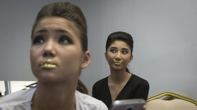 Models wait backstage during Kazakhstan Fashion Week in Almaty, Kazakhstan