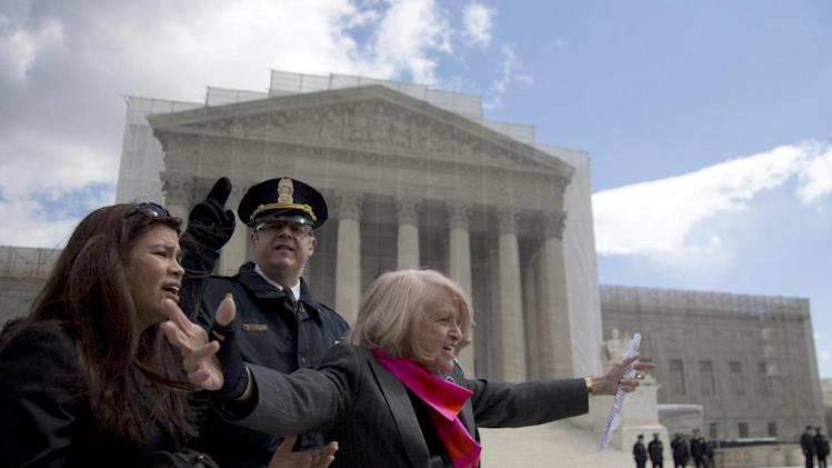 Plaintiff Edith Windsor of New York waves to supporters in front of the Supreme Court in Washington, Wednesday, March 27, 2013, after the court heard arguments on the Defense of Marriage Act (DOMA) case. The U.S. Supreme Court, in the second day of gay marriage cases, turned Wednesday to a constitutional challenge to the federal law that prevents legally married gay Americans from collecting federal benefits generally available to straight married couples. (AP Photo/Carolyn Kaster)