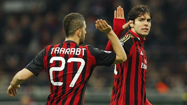 AC Milan's Kaka (R) high fives Adel Taarabt during their Champions League round of 16 first leg against Atletico Madrid (Reuters)