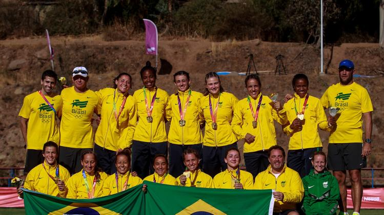 Brazil Rugby team pose for the media after winning gold medals on the Women's Rugby competition at the South American Games in Santiago