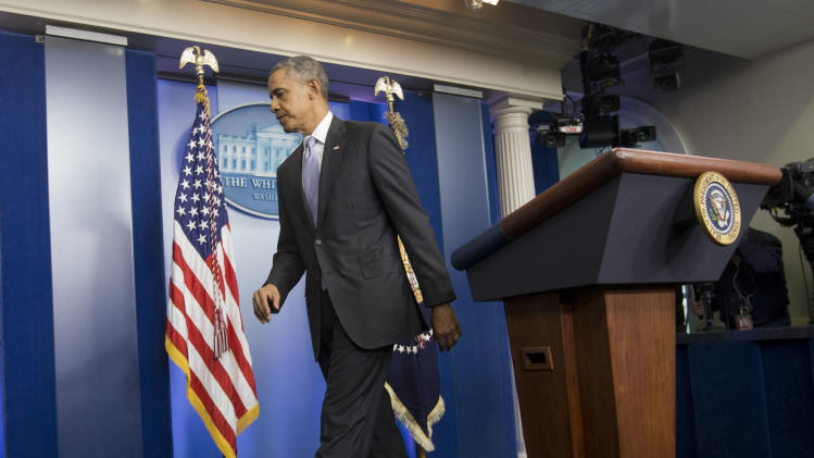 "President Barack Obama walks away from the podium after speaking about the ongoing situation in Ukraine in the Brady Press Briefing Room of the White House in Washington, Friday, Feb. 28, 2014. Obama warned Russia ""there will be costs"" for any military intervention in Ukraine. (AP Photo/Pablo Martinez Monsivais)"