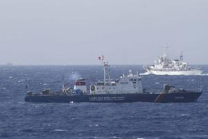 File photo of a ship of the Chinese Coast Guard near a ship of the Vietnam Marine Guard in the South China Sea