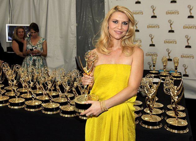 Actress Claire Danes, winner Outstanding Lead Actress In A Drama Series for Homeland, poses backstage at the 64th Primetime Emmy Awards at the Nokia Theatre on Sunday, Sept. 23, 2012, in Los Angeles. (Photo by Matt Sayles/Invision/AP)