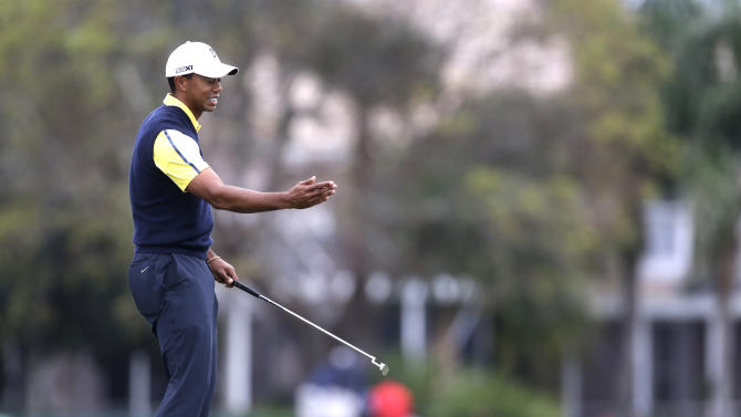 Tiger Woods reacts to missing a putt on the 15th hole during the second round of the Honda Classic golf tournament on Friday, March 1, 2013, in Palm Beach Gardens, Fla. (AP Photo/Wilfredo Lee)