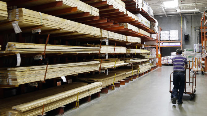 FILE - In this Aug. 14, 2012, file photo, a customer walks past building products at a Home Depot store in Nashville, Tenn.  A boost from the gradually recovering housing market helped Home Depot's net income edge up in its fiscal third quarter_the world's biggest home-improvement retailer said Tuesday, Nov. 13, 2012, that its net income rose to $947 million, or 63 cents per share for quarter that ended Oct. 28. (AP Photo/Mark Humphrey, File)