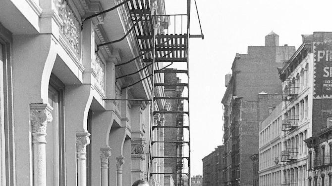 FILE - In this March 17, 1980 file photo, Stan and Julie Patz stand on the 2nd-floor fire escape of the of their loft in the Soho neighborhood of New York.  Below them runs Prince Street, along which Etan, their 6-year-old son, set off to school on May 25, 1979, and has not been seen since. On Thursday, April 19, 2012, a team of police officers and FBI agents started to begin tearing apart the basement of a building about a block from where the family lived as part of the decades-old investigation into the disappearance of the boy. Authorities have not said whatevidence led them to that location. (AP Photo/Marty Reichenthal, File)
