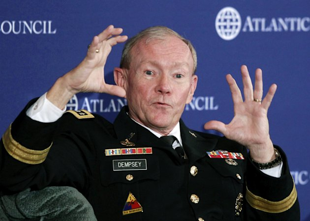 FILE - In this Dec. 9, 2011, file photo, Joint Chiefs Chairman Army Gen. Martin Dempsey speaks at the Atlantic Council in Washington. Dempsey says the problem of rogue Afghan soldiers and police turning their guns on American and allied troops is a &quot;very serious threat&quot; to the war effort. Dempsey says the Afghan government needs to take the problem as seriously as do U.S. and NATO commanders and officials. He says &quot;you can&#39;t whitewash&quot; the problem, and that it can&#39;t be fixed by just working harder. (AP Photo/Charles Dharapak, File)