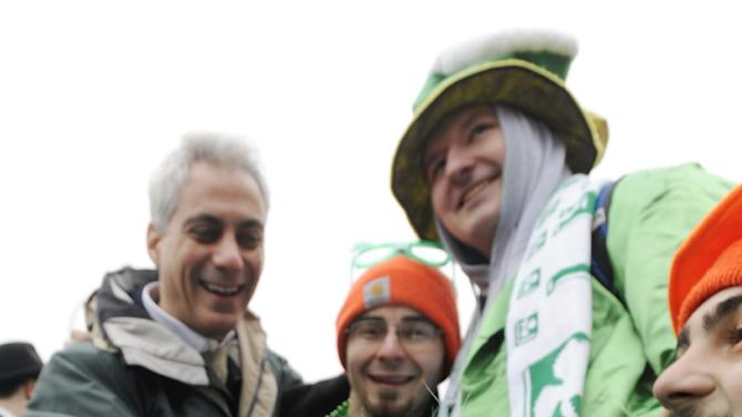 "Chicago Mayor Rahm Emanuel left, poses for a photo with ""Shamrock"" the green dyed Irish Wolfhound and from left, Clancy Shanahan, Tony Shanahan and Cavan Shanahan before the St. Patrick's Day parade in Chicago, Saturday, March, 16, 2013. (AP Photo/Paul Beaty)"