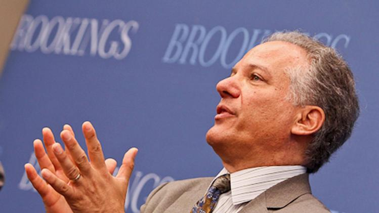 """This handout photo provided by the Brookings Institution, and taken on June 25, 2013, shows Health and Human Services Director of the Center for Consumer Information and Insurance Oversight Gary Cohen speaking at the Institution in Washington. A partial government shutdown next week would leave the major parts of President Barack Obama's health care law in place and humming right along. That's according to former Democratic and Republican budget officials, as well as the Obama administration itself. """"Many of the core parts of the health care law are funded through mandatory appropriations and wouldn't be affected,"""" Cohen, the HHS official overseeing the health care rollout, told reporters this week. (AP Photo/Brookings Institution, Paul Morigi)"""