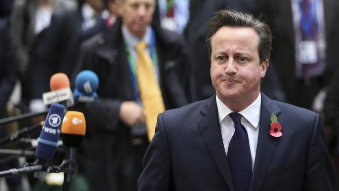 Britain's PM Cameron arrives at an European Union leaders summit in Brussels