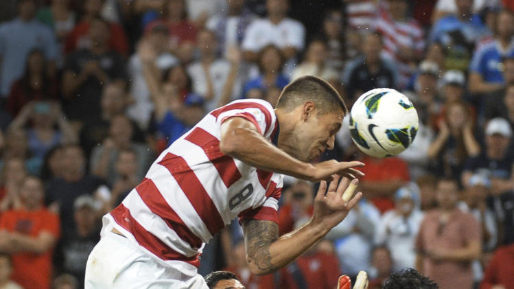 U.S. forward Clint Dempsey (8) tries a header against Guatemala goalkeeper Ricardo Jerez Jr. (1) as Guatemala defender Jonathan Lopez (23) watches during the second half of a World Cup qualifying soccer match in Kansas City, Kan., Tuesday, Oct. 16, 2012. (AP Photo/Reed Hoffmann)