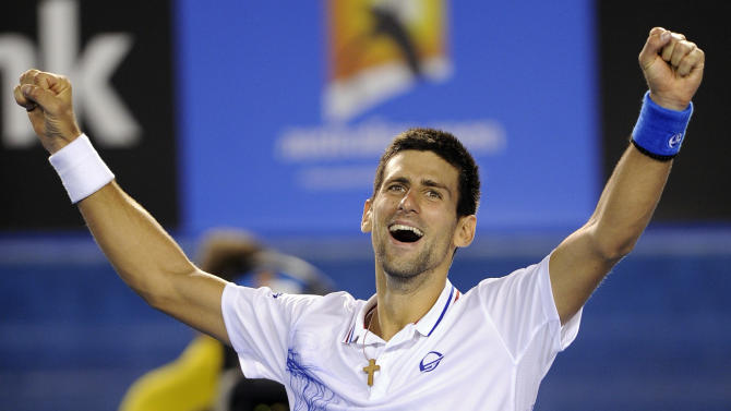 Novak Djokovic of Serbia celebrates after defeating Andy Murray of Britain during their semifinal at the Australian Open tennis championship, in Melbourne, Australia, early Saturday, Jan. 28, 2012. (AP Photo/Andrew Brownbill)
