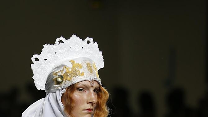 A model wears an outfit by designers Fashion East during their Spring/Summer 15 show at London Fashion Week in London, Tuesday, Sept. 16, 2014. (AP Photo/Alastair Grant)