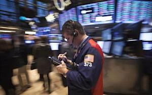 A trader walks on the floor of the New York Stock Exchange at the market open in New York, October 28, 2013. REUTERS/Carlo Allegri