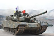 A South Korean K-1 tank moves over a temporary bridge during a military drill in Hwacheon near the border with North Korea, on April 1, 2013. South Korea's new president has promised a strong military response to any North Korean provocation after Pyongyang announced that the two countries were now in a state of war