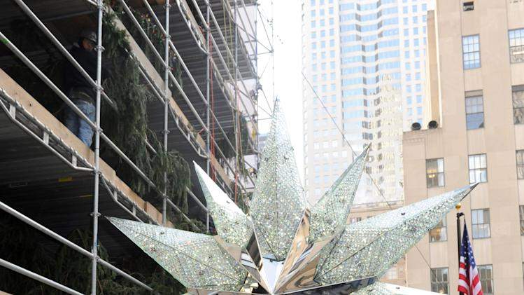 IMAGE DISTRIBUTED FOR SWAROVSKI - Jennifer Hinkle, of Swarovski North America, unveils the 2012 Swarovski Star that will sit atop the Rockefeller Center Christmas Tree, Tuesday, Nov. 20, 2012, in New York, which features 25,000 crystals and weighs 550 pounds. Swarovski is the leading designer and producer of fashion jewelry and crystal decor objects. (Diane Bondareff/Invision for Swarovski/AP Images)