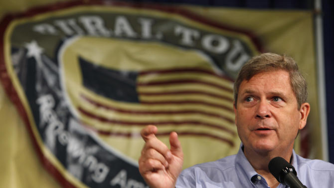FILE - U.S. Agriculture Secretary Tom Vilsack speaks during a Rural Tour stop at the Iowa State Fair, in this Aug. 19, 2009 file photo taken in Des Moines, Iowa. A remote Alaska Native village where only half the homes have indoor plumbing is among rural communities nationwide that will receive upgrades to rural water and wastewater systems with $352 million in grants and loans from the U.S. Department of Agriculture. Vilsack is scheduled to announce the funding Thursday Oct. 23, 2014 at a convention of Alaska Natives in Anchorage. (AP Photo/Charlie Neibergall, File)