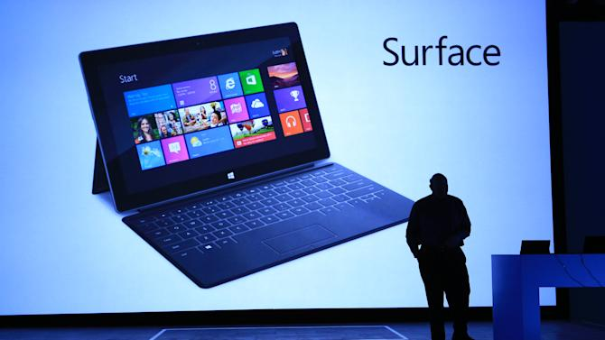 OMMERCIAL IMAGE - In this photograph taken by AP Images for Microsoft, Steve Ballmer, Microsoft Chief Executive Officer, reveals Surface, a new family of PCs, for Windows, Monday, June 18, 2012, in Los Angeles. (Rene Macura/AP Images for Mircrosoft)
