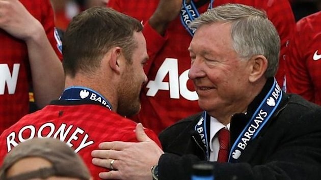 Manchester United manager Sir Alex Ferguson speaks with Wayne Rooney (Reuters)