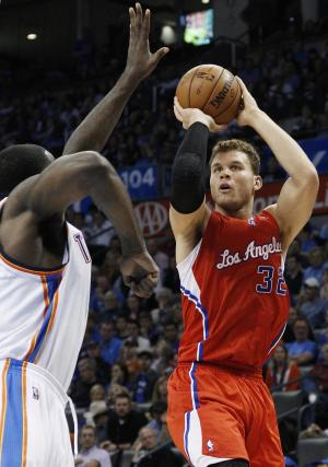 Los Angeles Clippers forward Blake Griffin shoots over Oklahoma City Thunder center Kendrick Perkins in the second quarter of an NBA basketball game in Oklahoma City, Wednesday, Nov. 21, 2012. (AP Photo/Sue Ogrocki)
