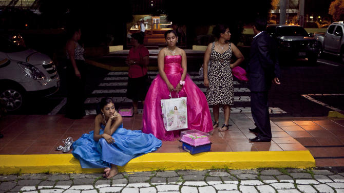 "Nicaraguan girls suffering from cancer wait for a car to leave after a ""quinceanera"" party in Managua, Nicaragua, Saturday Sept. 21, 2013. For each of the past five years, Nicaragua's Association of Mothers and Fathers of Children with Cancer and Leukemia has put on a ""quinceanera"" party for girls from poor, rural families, teens who have the added burden of dealing with cancer. This year's party feted 37 girls between ages 14 and 16 on Saturday night at a hotel in Nicaragua's capital.(AP Photo/Esteban Felix)"