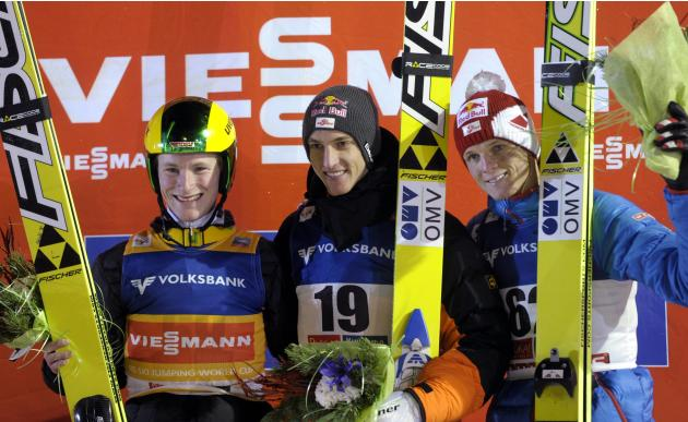 First placed Schlierenzauer of Austria, second placed Kraus of Germany and third placed Morgernstern of Austria celebrate on the podium after the men's Ski Jumping HS 142 Large Hill Individual competi