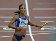 France's Christine Arron competes in the women's 4x100m relay semi-final of the 2012 European Athletics Championships at the Olympic Stadium in Helsinki on June 30, 2012. The former European 100 metres sprint champion has announced that she is calling time on her career at the age of 39